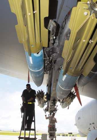 USAF photo by SSgt. Jamie Powell SSgt. Dustin Hyden (l) and SSgt. Doyle Atkinson load weapons onto a B-52. In the next decade, $40.