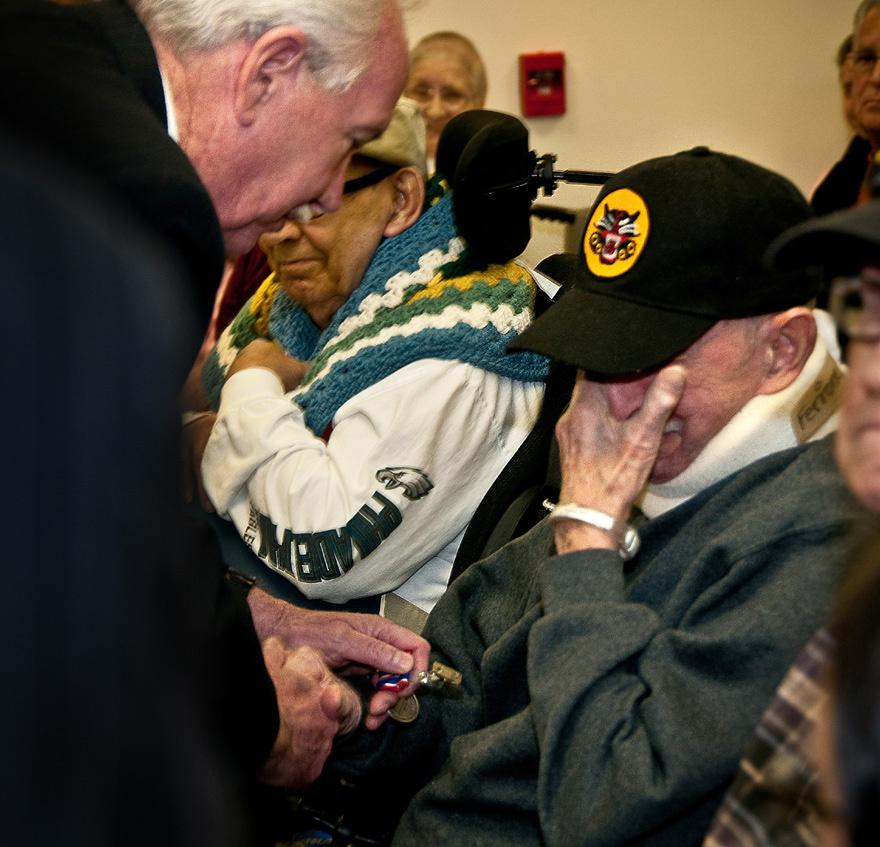 Right, Vito Ferrone, a World War II Army veteran, becomes emotional as he receives the NJ DSM from Zawacki. Below, the New Jersey Distinguished Service Medal. (Photos by Staff Sgt.