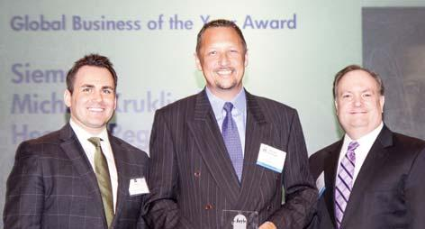 in presenting the 2012 Award to Kyle Schoppmann who accepted the award on behalf of CBRE CEO Mary Ann Tighe.