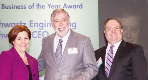 Small Business of the Year Christine Quinn and Joe Kirk present the award to
