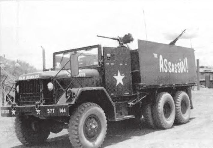 systems on gun trucks. A sandbagged dog house was mounted on the back of some trucks to house a squad automatic weapon gunner.