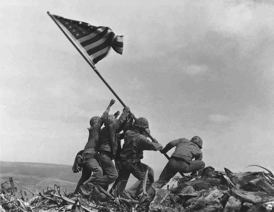 Iwo Jima critical as base from which planes can reach Japan 6,000 marines die taking island; of 20,700 Japanese, 200