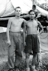 Andy Nicoll and Andil anak Unting (Iban tracker), B Company, 1 KOSB, at Niyor Rubber estate, near Kluang, mid/late 1950's.