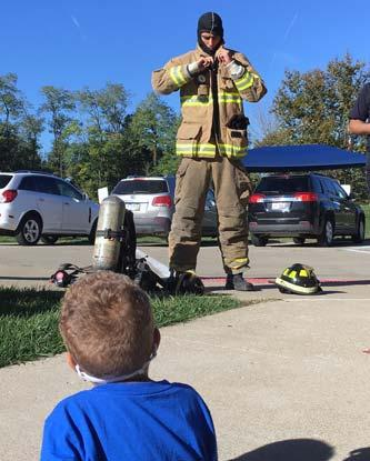The students learned how to crawl low to get out of a fire.